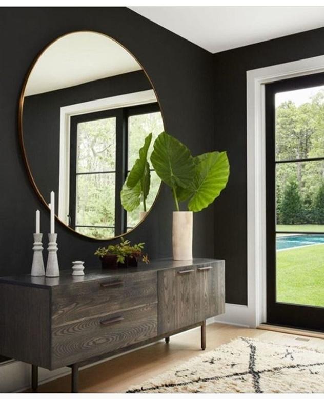 decoração com espelho redondo no quarto